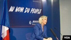 FILE - Marine Le Pen of the National Front party is seen as making the runoff in the French presidential election but failing to win. (L. Bryant/VOA)