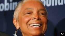 FILE - Dr. Camille Cosby, wife of comedian Bill Cosby, attends the Jackie Robinson Foundation annual awards dinner, March 3, 2008, in New York. Lawyers for Bill Cosby's wife have filed an emergency motion to postpone her deposition while she appeals a magistrate judge's order.