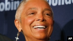 FILE - Dr. Camille Cosby, wife of comedian Bill Cosby, attends the Jackie Robinson Foundation annual awards dinner, March 3, 2008, in New York.