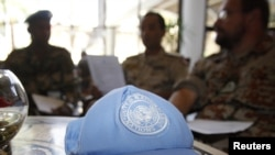 A blue United Nations cap is left near members of the U.N. observers mission in Syria, who have left their bases in the province of Homs in Central Syria, as they check their departure dates in a hotel in Damascus August 20, 2012.