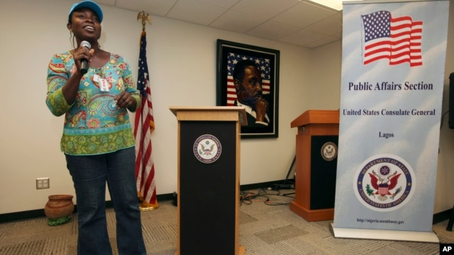 FILE - Abosede Oladayo, an AIDS activist living with HIV, speaks during an event to mark World Aids Day at the U.S. Embassy in Lagos, Nigeria, Dec. 2, 2011. Groups fighting AIDS warned Jan. 14, 2014, that a new Nigerian law criminalizing same-sex marriage, gay organizations will harm anti-AIDS efforts.