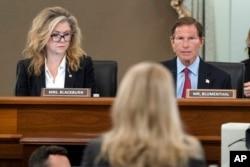 Sen. Marsha Blackburn, R-Tenn., left, and Sen. Richard Blumenthal, D-Conn., right speak to former Facebook data scientist Frances Haugen, center, during a hearing on Capitol Hill, Oct. 5, 2021.