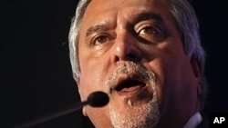 FILE - Vijay Mallya peaks during a media conference in Mumbai, India, Nov. 15, 2011. Finance Minister Arun Jaitley says India will begin extradition proceedings from Britain once official charges are filed against the businessman.