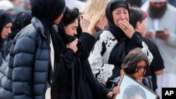 FILE - Mourners arrive for a burial service of a victim from the March 15 mosque shootings at the Memorial Park Cemetery in Christchurch, New Zealand, March 21, 2019.