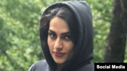 Iranian student and activist Maryam Faraji, 33, arrested in early January for participating in anti-government protests, is seen in this undated image shared on social media.