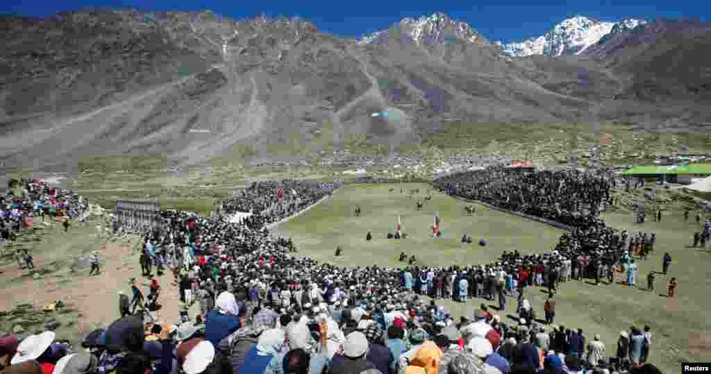 Spectators gather to watch a polo match during the annual Shandur Polo Festival, at Shandur Pass, at an estimated altitude of around 3,700 meters, in Chitral, Pakistan, July 9, 2019.