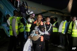 Nigerian returnees from Libya disembark from a plane upon arrival at the Murtala Muhammed International Airport in Lagos, Nigeria, Dec. 5, 2017.