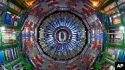 FILE - Researchers at the CERN physics lab near Geneva, used the $5.5 billion atom smasher, called the Large Hadron Collider, to confirm the existence of the Higgs boson particle.
