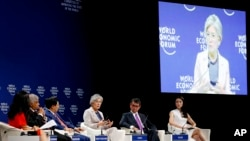 South Korean Foreign Minister Kang Kyung-Wha, center, gestures during a discussion on Asia's Geopolitical Outlook in the ongoing World Economic Forum on ASEAN at the National Convention Center Thursday, Sept. 13, 2018, in Hanoi, Vietnam. Listening from left are, moderator Julie Yoo, Sri Lankan Prime Minister Ranil Wickremesinghe, Vietnamese Deputy Prime Minister, and Foreign Minister Pham Binh Minh, Kang, Japanese Foreign Minister Taro Kono, and Lynn Kuok of the Institute of International Strategic Studies, Singapore. The World Economic Forum has attracted hundreds of participants with the theme: ASEAN 4.0: Entrepreneurship and the Fourth Industrial Revolution. (AP Photo/Bullit Marquez)