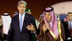 U.S. Secretary of State John Kerry, left, is escorted by Saudi Foreign Minister Prince Saud Al-Faisal bin Abdulaziz al-Saud, as Kerry arrives in Riyadh, Saudi Arabia, Nov. 3, 2013.