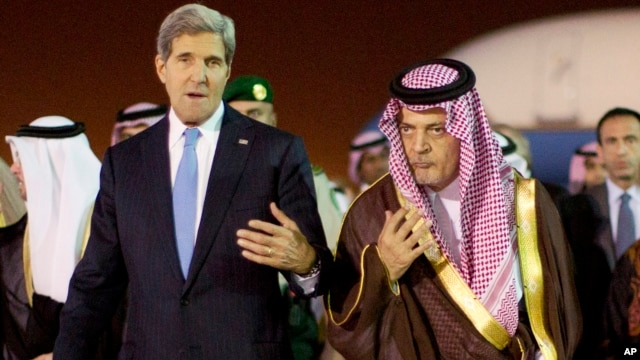 U.S. Secretary of State John Kerry, left,  is escorted by Saudi Foreign Minister Prince Saud Al-Faisal bin Abdulaziz al-Saud, as Kerry arrives in Riyadh, Saudi Arabia, Nov. 3, 2013.