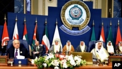 Emir of Kuwait, Sheikh Sabah al-Ahmad al-Sabah, right, and Secretary-General of the League of Arab States, Nabil El Araby, left, attend the closing session of the Arab League Summit at Bayan Palace, Kuwait, March 26, 2014.
