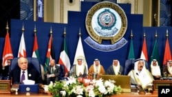FILE - The closing session of the Arab League Summit at Bayan Palace, Kuwait, March 26, 2014.