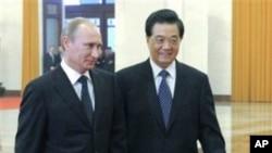 中國國家主席胡錦濤(右)歡迎俄羅斯總理普京(左)到北京訪問