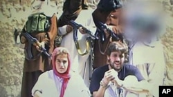 This image shows what is believed to be a Swiss couple, abducted by the Pakistani Taliban in Baluchistan, Pakistan, in July this year, taken from a militant video that emerged October 25, 2011.