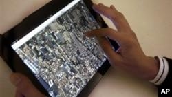 Aplikasi peta baru Apple Maps yang menggantikan Google Maps yang ada di sistem operasi iPhone dan iPad. (AP/Karly Domb Sadof)