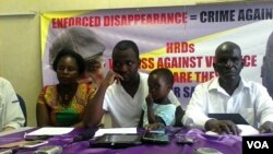 Itai Dzamara's wife, Sheffra, seen here with her brother-in-law Patson Dzamara and family attorney.