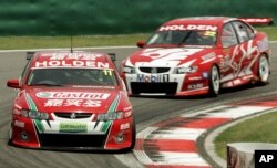 New Zealand's Steven Richards, 11, and Australian Todd Kelly, 22, during the Race 2 of V8 Supercars Shanghai Round, June 12, 2005 at Shanghai International Circuit in Shanghai, China. Mark Skaife of Holden racing Team finished the first place, Richards in second and Kelly in third.