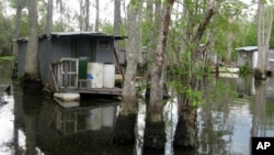 Yes, people live (somewhat primitively) in the heart of the swamp. Or at least keep fishing cabins - and lots of mosquito repellant - there