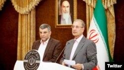 İran Sağlık Bakan Yardımcısı Iraj Harirchi ve İran Hükümet Sözcüsü Ali Rabii