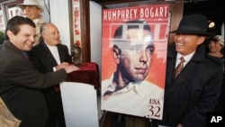 FILE - The 'Maltese Falcon' statuette is seen at the unveiling of the U.S. Postal Service's Humphrey Bogart stamp in San Francisco on Aug. 1, 1997.