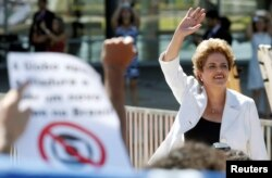 FILE - Suspended Brazilian President Dilma Rousseff waves to supporters after the Brazilian Senate voted to impeach her for breaking budget laws, at Planalto Palace in Brasilia, Brazil, May 12, 2016.