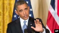 """美國總統奧巴馬星期一在白宮稱共和黨對於班加西攻擊案處理方式的批評是 """"政治雜耍表演""""。"""