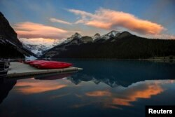Canoes are seen on a dock on Lake Louise at Banff National Park, in the Canadian Rocky Mountains.