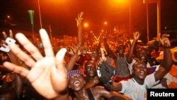 Des Ivoiriens dans Abidjan, 8 février 2015