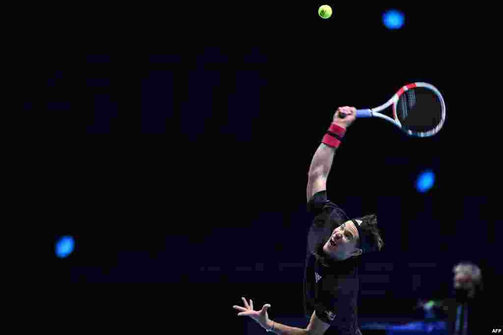 Austria's Dominic Thiem serves against Greece's Stefanos Tsitsipas in their men's singles round-robin match on day one of the ATP World Tour Finals tennis tournament at the O2 Arena in London.