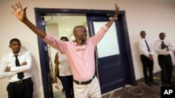 Presidential candidate Jovenel Moise from the PHTK political party waves to supporters as he arrives to a press conference in Port-au-Prince, Haiti, Nov. 5, 2015.