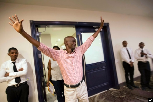 FILE - Presidential candidate Jovenel Moise waves to supporters as he arrives to a news conference in Port-au-Prince, Haiti, Nov. 5, 2015.