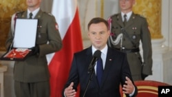 Poland's new President Andrzej Duda speaks during his inauguration ceremony at the Royal Castle in Warsaw, Poland, August 6, 2015.