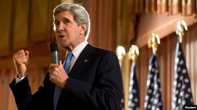 U.S. Secretary of State John Kerry speaks to staff from the U.S. Embassy in Kuwait City, Kuwait, June 26, 2013.