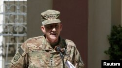 U.S. Army General John Nicholson, Commander of Resolute Support forces and U.S. forces in Afghanistan, speaks during a memorial ceremony to commemorate the 15th anniversary of the 9/11 attacks, in Kabul, Afghanistan, Sept. 11, 2016.