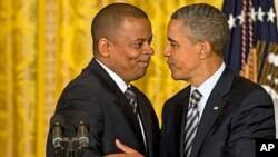 President Barack Obama (r) and Anthony Foxx, nominated as transportation secretary succeeding Ray LaHood, April 29, 2013.