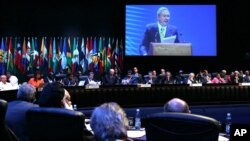 A large screen shows Cuba's President Raul Castro speaking at the opening ceremony of the CELAC Summit in Havana, Jan. 28, 2014.