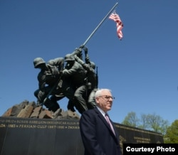 David Rubenstein, at the U.S. Marine Corps War Memorial, known popularly as the Iwo Jima Memorial, is helping to fund the restoration of the iconic statue in Virginia. April 2015. (Credit: National Park Service)