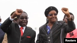 FILE - Zimbabwean President Robert Mugabe and his wife Grace wave to supporters and guests during celebrations to mark his 90th birthday in Marondera about 80km (50 miles) east of the capital Harare, Feb. 23, 2014. Mugabe turned 90 on February 21. (Reuters)