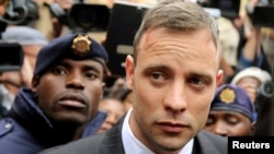 Olympic and Paralympic track star Oscar Pistorius leaves court after appearing for the 2013 killing of his girlfriend Reeva Steenkamp in the North Gauteng High Court in Pretoria, South Africa, June 14, 2016.
