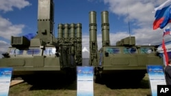 FILE - Russia's sophisticated S-300 air defense systems is on display at the opening of the MAKS Air Show in Zhukovsky, outside Moscow, Russia, Aug. 27, 2013.