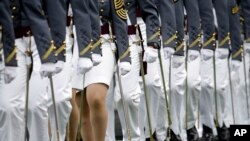 FILE - Graduating cadets march during a graduation and commissioning ceremony at the U.S. Military Academy in West Point, New York, May 21, 2016. U.S. military academies saw a rise in sexual assault reports last year.