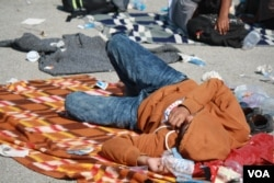 By the time they get to Croatia, many travelers are exhausted and sleep where ever they can find a place to lie down. (VOA / H. Murdock)