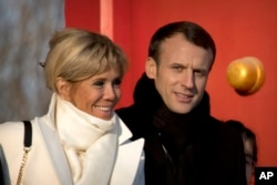 French President Emmanuel Macron and his wife Brigitte Macron visit the Forbidden City in Beijing, Jan. 9, 2018.