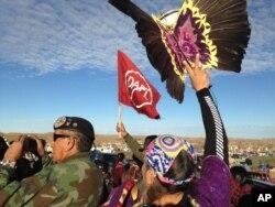 Demonstrators against the Dakota Access oil pipeline hold a ceremony at the main protest camp near Cannon Ball, North Dakota, Nov. 15, 2016.