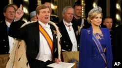 Dutch King Willem-Alexander takes the oath as he wife Queen Maxima stands at his side during his inauguration inside the Nieuwe Kerk or New Church in Amsterdam, The Netherlands, Apr. 30, 2013.