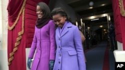 President Barack Obama's daughters Malia Obama, left, and Sasha Obama arrive on the West Front of the Capitol in Washington, Monday, Jan. 21, 2013, for the president's ceremonial swearing-in.