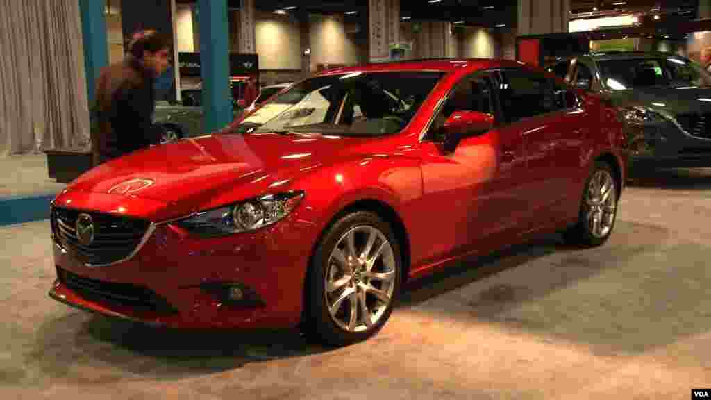 An attendee of the Washington Auto Show checks out a new Mazda