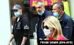 People wearing protective face masks amid the ongoing coronavirus COVID-19 pandemic in Sarajevo, 05 May 2020
