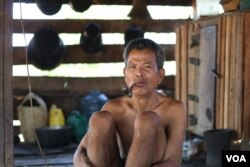 Kasol Met, 73, a Kachork ethnic villager, told VOA that he has lost one hectare of land to the Vietnamese rubber company. (Sun Narin/VOA Khmer)